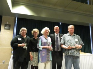 """Here the editors of a book of poetry pose with two local library directors who handed out the awards. They won an honorable mention for the book """"Amethyst and Agate: Poems of Lake Superior."""" From left are: Pamela Mittlefehldt, Carla Powers (Director of the Duluth Library) Mara Hart, Matt Rosendahl (Director of the University Library) and Jim Perlman. (Photo by Naomi Yaeger)"""